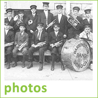 Black and white photo of old Barrington School Band, band members wearing uniforms, bass drum, text reads photos